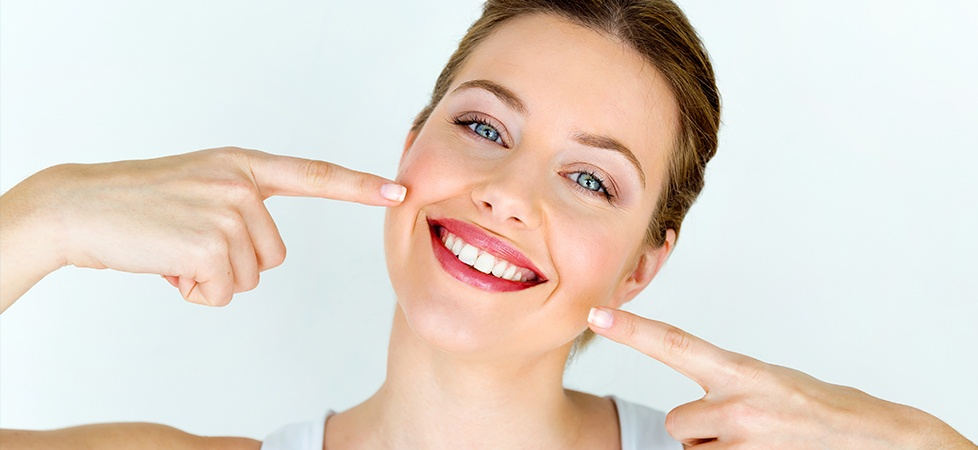 woman pointing to perfect smile