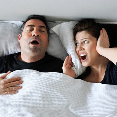 woman mad at husband yawning