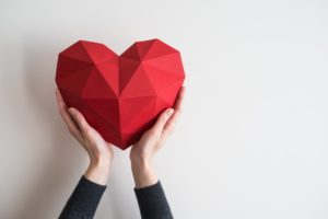 person holding crafted heart