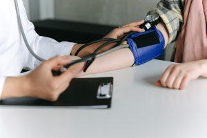 Why does my dentist take my blood pressure