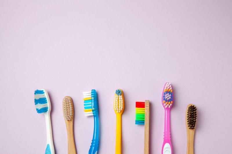 row of colored toothbrushes